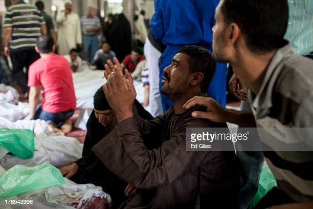 An Egyptian man identifies the body of a family member a supporter of deposed Egyptian President Mohammed Morsi killed during a violent crackdown by...