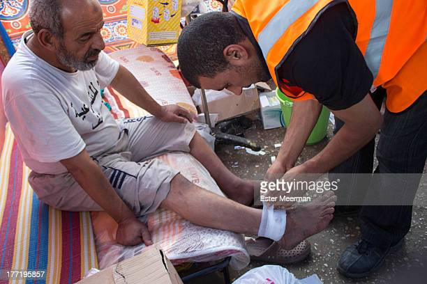 An Egyptian man is receiving first aid at one of the field hospitals at the Rabaa Al Adaweyya sit-in by the pro-Morsi protesters in the upscale...