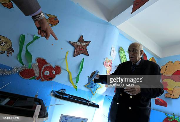 An Egyptian man is shown where to cast his ballot at a polling station in Cairo's Zamalek neighbourhood on January 29 2012 during the first stage of...