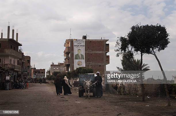 An Egyptian man leads a donkey pulling a cart in President Mohamed Morsi's hometown Adwa in the Nile Delta on December 15 2012 Egypt's opposition...