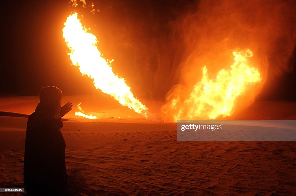 An Egyptian man looks at flames rising f : News Photo