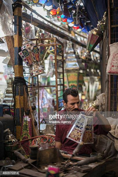 An Egyptian man makes traditional tin lanterns used by Egyptians to decorate during the holy month of Ramadan in his workshop in Cairo Egypt on June...