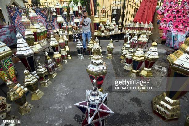 An Egyptian man sells traditional lanterns known in Arabic as 'Fanous' sold during Ramadan in Cairo's Saida Zeinab district on May 24 ahead of the...