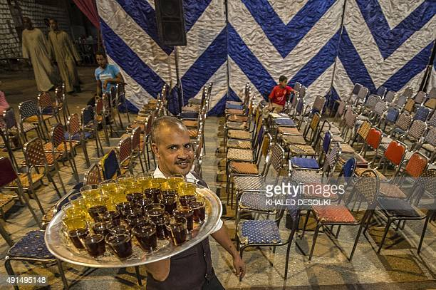 GABRIEL An Egyptian man serves tea during a campaign meeting of the main 'For The Love of Egypt' coalition ahead of the parliamentary elections on...