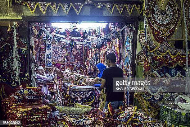 An Egyptian man shops for traditional decoration sold during the Muslim holy month of Ramadan, in the capital Cairo on June 2, 2016. More than 1.5...