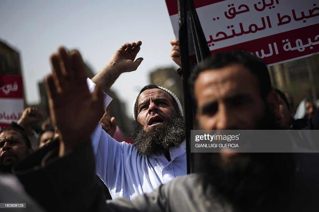 An Egyptian man shouts religious and political slogans as hundreds of Salafists demonstrate over a lack of enforcement of a recent court order permitting bearded police officers to serve in Cairo on March 1, 2013.