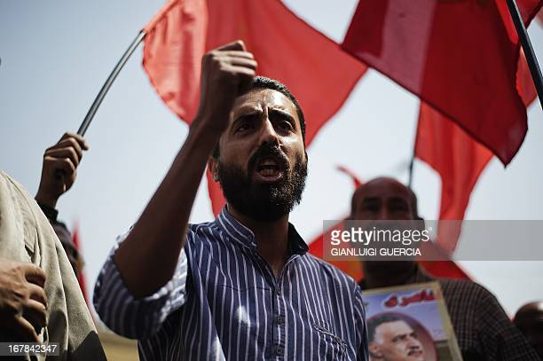 An Egyptian man shouts slogansduring a demonstration of members of the Egyptian Communist party alongside with workers and political activists to...