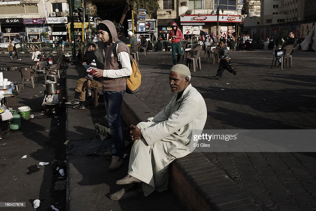 An Egyptian man sits on a concrete platform among protesters in Tahrir Square on January 31, 2013 in Cairo, Egypt. Protests continued across Egypt nearly one week after the second anniversary of the Egyptian Revolution that overthrew former President Hosni Mubarak on January 25, 2011. Further protests are expected over the coming weekend to commemorate the first anniversary of the Port Said football massacre, when over 70 fans of the Cairo-based Al Ahly football club were killed in a violent post-match brawl between fans of the opposing teams inside the Port Said football stadium after a match between the Al Ahly and Al Masry football teams.