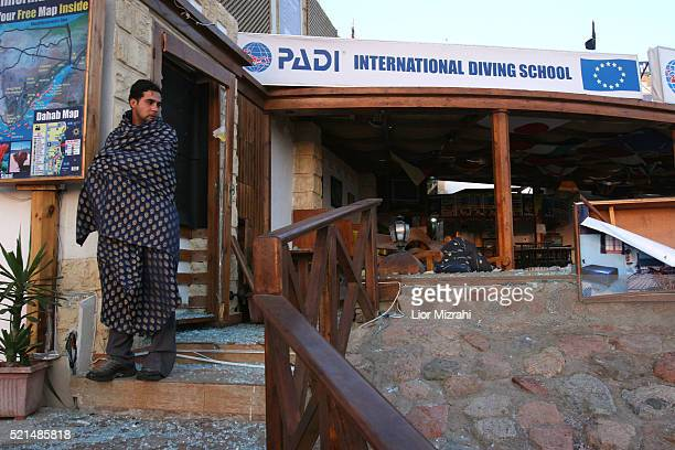 An Egyptian man standing at the site where a bomb exploded in the Egyptian resort in the city of Dahab early Tuesday April 25 2006 Three nearly...