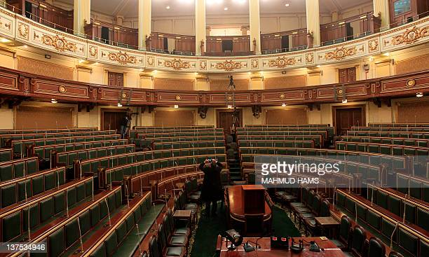 An Egyptian man takes pictures inside the parliament meeting hall in Cairo on January 22 2012 Egypt's newly elected parliament will convene for its...