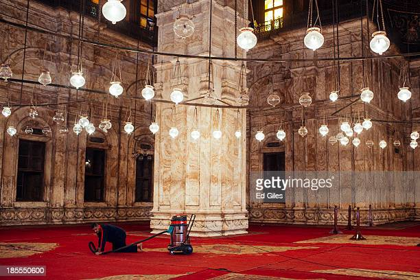 An Egyptian man vacuums the carpet at the Muhammad Ali Mosque in Cairo's Citadel on October 21 2013 in Cairo Egypt The Muhammad Ali Mosque completed...