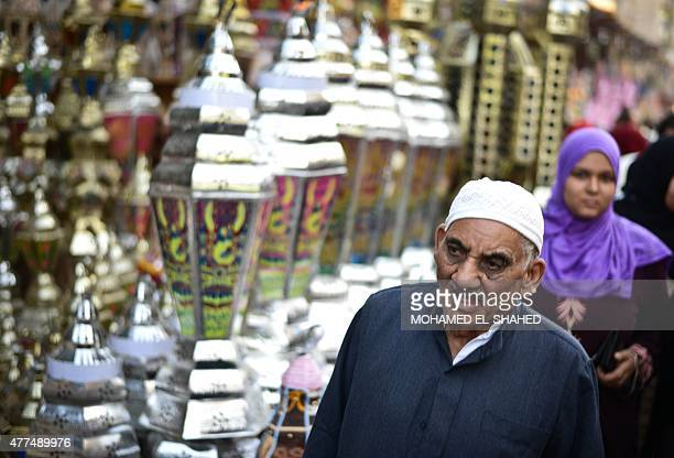 An Egyptian man walks past traditional lanterns known in Arabic as 'Fanous' sold during the Muslim holy month of Ramadan in the Saida Zeinab district...