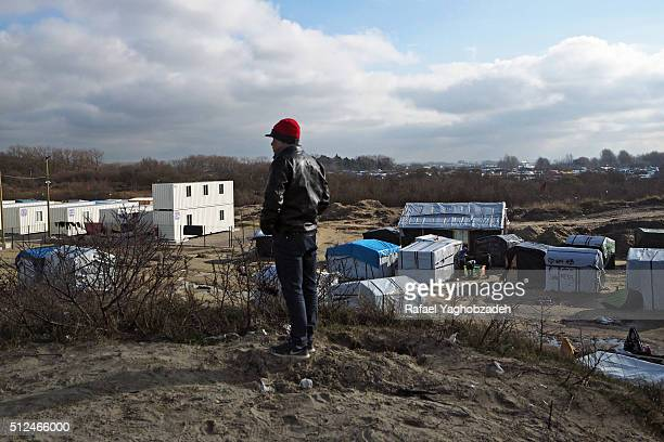 An Egyptian migrant stands on a hill in the 'Jungle' migrant camp on February 23 2016 in Calais France Plans to evacuate hundreds of migrants from...