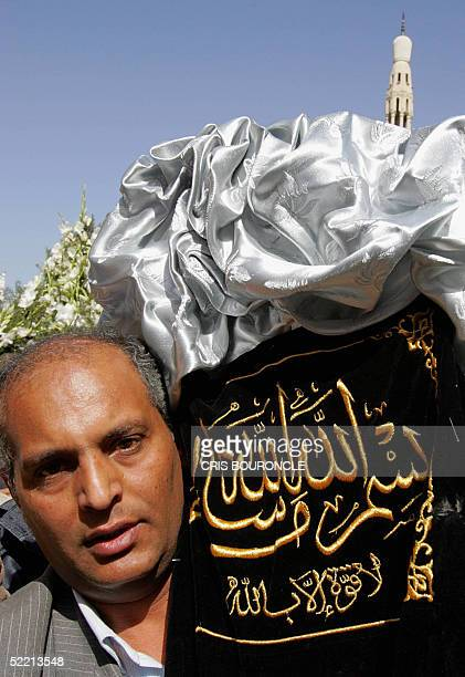An Egyptian mourner carries the coffin of late former Egyptian Queen Nariman Sadeq exwife of the late King Farouk from the Omar Makram Mosque in...