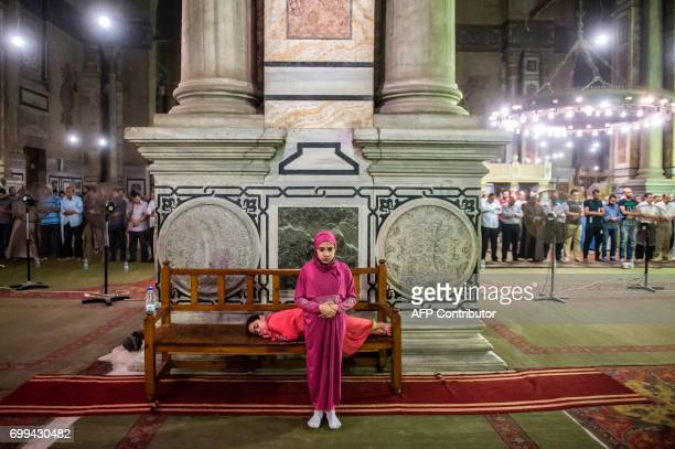 TOPSHOT An Egyptian Muslim girl performs Tarawih prayers on the occasion of Laylat alQadr which falls on the 27th day of the fasting month of Ramadan...