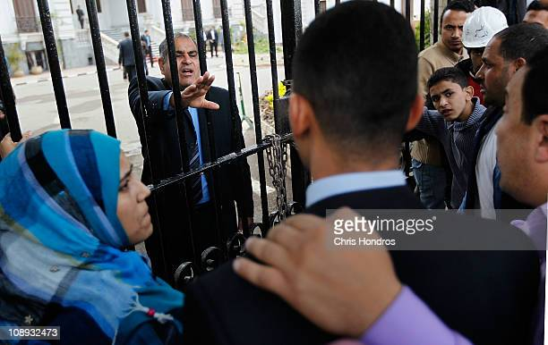 An Egyptian official tries to calm a group of antigovernment protesters demonstrating outside the Ministry of Health building on February 9 2011 in...