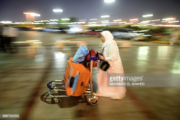 An Egyptian pilgrim arrives at the Cairo International Airport late on August 25 for her departure to the annual Hajj pilgrimage in the Islamic holy...