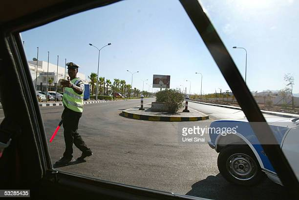 An Egyptian policeman directs traffic on an otherwise empty street on July 25 2005 in the Egyptian Red Sea resort of Sharm elSheikh With foreign...
