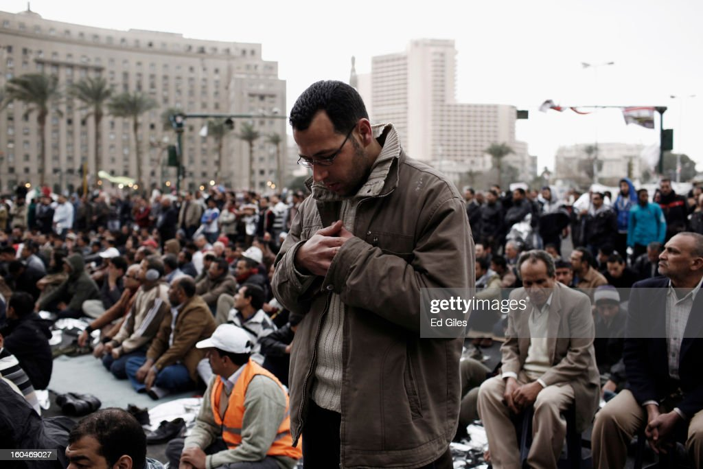 An Egyptian protester attends midday prayers during a protest against Egyptian President Mohammed Morsi in Tahrir Square on February 1, 2013 in Cairo, Egypt. Protests continued across Egypt nearly one week after the second anniversary of the Egyptian Revolution that overthrew former President Hosni Mubarak on January 25, 2011. Further protests are expected Friday to commemorate the first anniversary of the Port Said football massace, when over 70 fans of the Cairo-based Al Ahly football club were killed in a violent post-match brawl between fans of the opposing teams inside the Port Said football stadium after a match between the Al Ahly and Al Masry football teams. (Photo by Ed Giles/Getty Images).