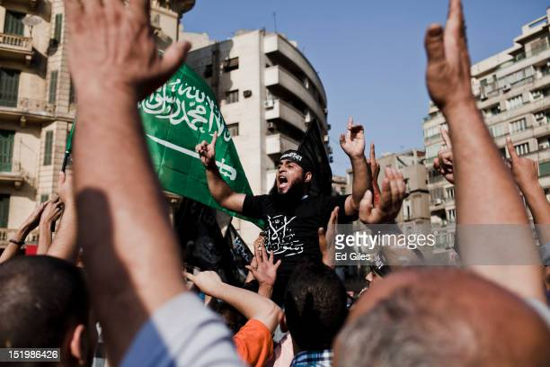 An Egyptian protester chants during a protest following midday prayers in Tahrir Square on September 14 2012 in Cairo Egypt Over two hundred people...