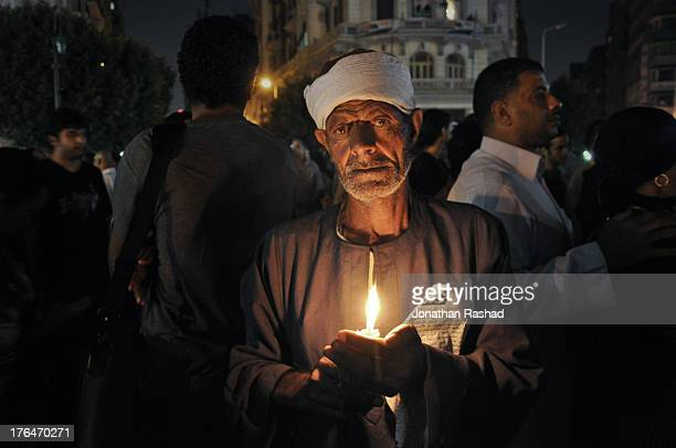 An Egyptian protester holds a candle in a candle-light vigil near Tahrir Square, Cairo, Egypt on October 13, 2011 in objection to the killing of 28...