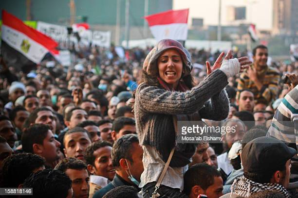 An Egyptian protester is carried on shoulders during protests against the military junta . The protests converged in Tahrir square in one of the...