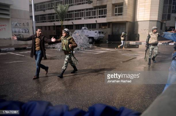 An Egyptian protester marches near Security Directorate in Port Said on February 1, 2012 in objection to a death-sentence issued for 21 football fans...