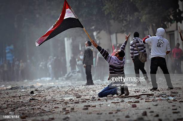 An Egyptian protester on his knees during clashing with army soldiers inside the Cabinet Ministry headquarters that overlooks the Qasr Ainy street,...