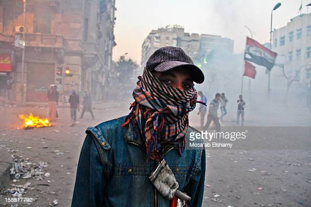 An Egyptian protester poses during clashes in Mohamed Mahmoud street, off Tahrir Square. The clashes started after more than 70 football fans of Ahly...
