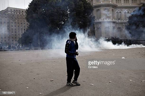 An Egyptian protester stands with a rock in his hand during a demonstration in Tahrir Square on January 27 2013 in Cairo Egypt Violent protests...