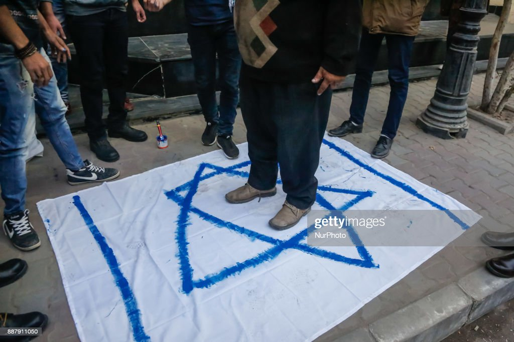 An Egyptian protester steps on an Israeli flag during a demonstration against the US president's recognition of Jerusalem as Israel's capital, on December 7, 2017, outside the Syndicate of Journalists Cairo's downtown district.