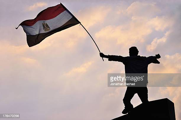 An Egyptian protester waves the Egyptian flag during protests in Tahrir Square on February 8, 2011 in Cairo, Egypt. The eighteen-day uprising led to...