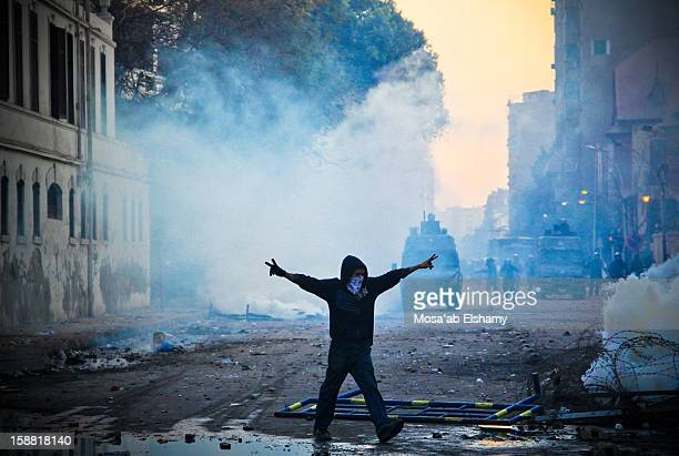 An Egyptian protester waves the victory sign during clashes with security forces in Mohammed Mahmoud street, off Tahrir Square. The clashes started...
