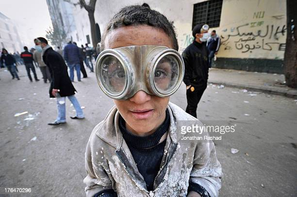 An Egyptian protester with a homemade teargas mask poses for a photo during clashes between Ultras Ahlawy of Cairo's alAhly club and riot police on...