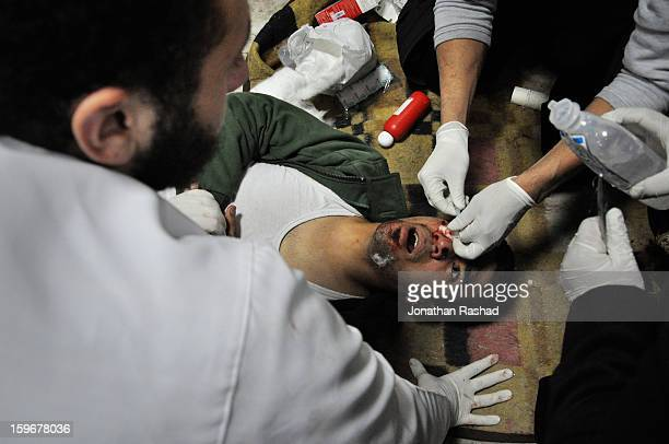 An Egyptian protesters getting treatment at the field hospital of Tahrir, after getting a birdshot pellet in his eye from police. On November 19,...