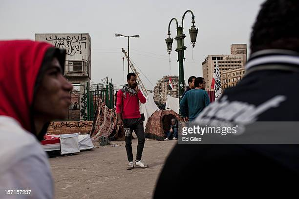 An Egyptian protesters speaks on a mobile phone near Tahrir Square on November 29 in Cairo Egypt Demonstrations continue in Cairo after more than a...