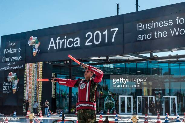 An Egyptian republican guard directs traffic at the entrance of the venue of the Africa 2017 Forum in the Red Sea resort of Sharm elSheikh on...