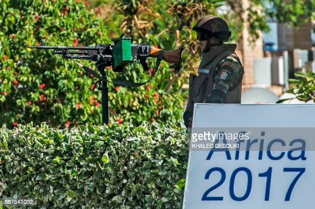 An Egyptian republican guard stands at the entrance of the Africa 2017 Forum in the Red Sea resort of Sharm elSheikh on December 7 as the African...