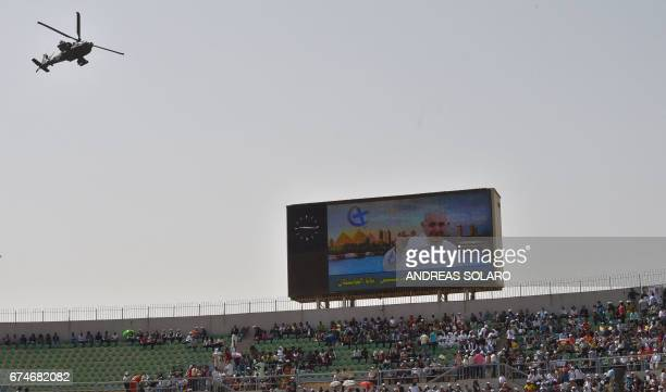An Egyptian security forces' AH64 Apache attack helicopter hovers above the stadium where Pope Francis leads mass on April 29 2017 in Cairo Pope...