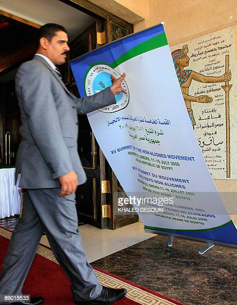 An Egy[ptian security guard catches a falling sign at the Foreign Affairs ministers meeting held prior to the presidential NonAligned Movement Summit...