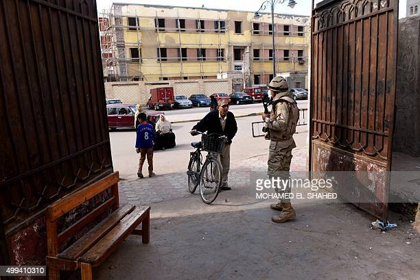 An Egyptian soldier stands guard at the entrance of a polling station during the runoff in the second phase of Egypt's parliamentary elections in...