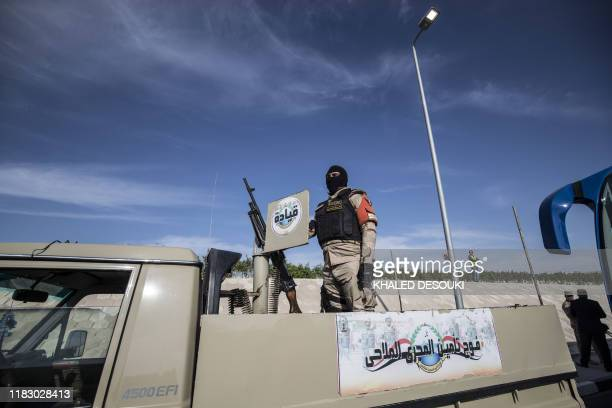 An Egyptian soldier stands guard during an organised tour for diplomats to mark the 150th anniversary of the inauguration of the Suez Canal in the...