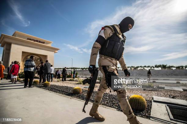 An Egyptian soldier walks away during an organised tour for diplomats to mark the 150th anniversary of the inauguration of the Suez Canal in the...