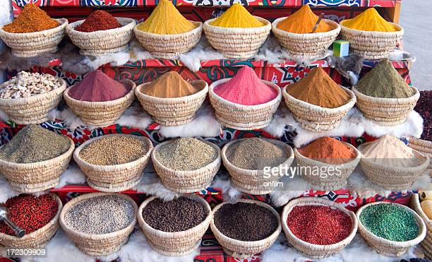 an egyptian spice market with baskets full of spice - egypt stock pictures, royalty-free photos & images