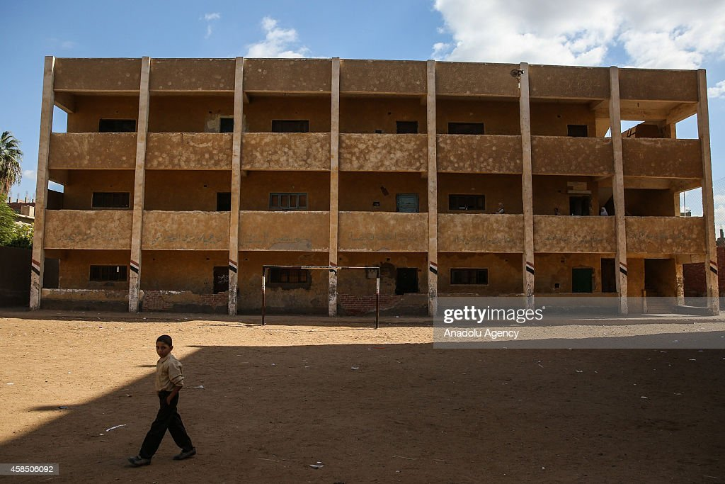An Egyptian student is seen at the garden of a primary school, where nearly 2 thousand students get education, in Baragil neighborhood of Giza, Egypt on October 30, 2014. Head master of the school complains about the crowded classroom sizes, reaching up to 70, lack of the desks and other impossibilities. Formal education, at every level, is provided freely at state schools in Egypt. Downswing due to the ongoing 4-year unrest, Egypt tries to overcome many difficulties and uncertainties.