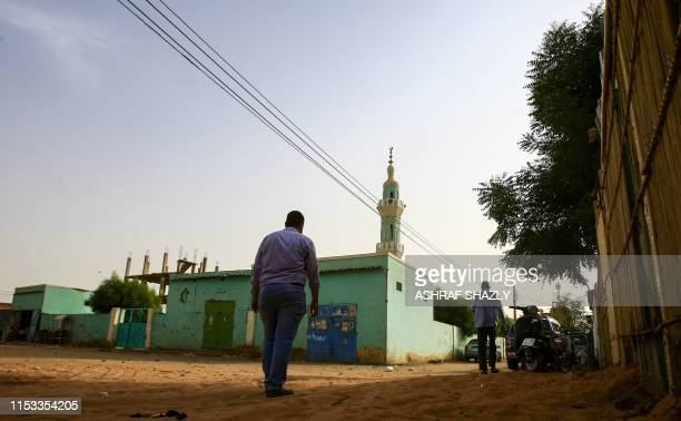 An Egyptian student who fled political repression in Egypt and moved to Sudan is pictured in Khartoum on June 27, 2019. - Supporters of the Muslim...