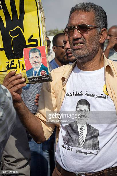 An Egyptian supporter of ousted president Mohamed Morsi and of the Muslim Brotherhood protest outside the Police Academy in New Cairo on the first...