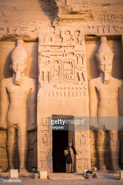 an egyptian temple watcher at nefertari's temple of hathor at abu simbel - god stock pictures, royalty-free photos & images