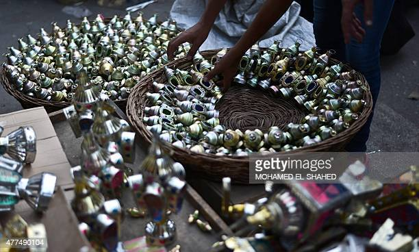 An Egyptian vendor organizes traditional lanterns known in Arabic as 'Fanous' sold during the Muslim holy month of Ramadan in the Saida Zeinab...