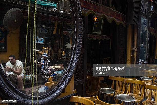 An Egyptian vendor waits for customers in his shop in Khan AlKhalili market in Cairo Egypton September 19 2016 The Khan elKhalili is a major souk in...
